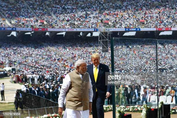 US President Donald Trump and India's Prime Minister Narendra Modi arrive to attend 'Namaste Trump' rally at Sardar Patel Stadium in Motera on the...