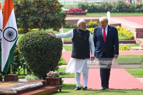 President Donald Trump and India's Prime Minister Narendra Modi arrive for a joint press conference at Hyderabad House in New Delhi on February 25,...