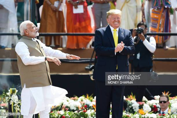 US President Donald Trump and India's Prime Minister Narendra Modi greet the crowd during 'Namaste Trump' rally at Sardar Patel Stadium in Motera on...