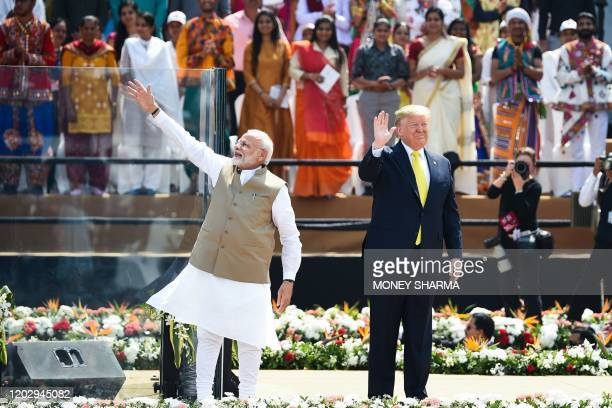 US President Donald Trump and India's Prime Minister Narendra Modi wave at the crowd during 'Namaste Trump' rally at Sardar Patel Stadium in Motera...