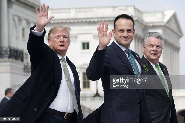 S President Donald Trump and Irish Taoiseach Leo Varadkar wave as US Rep Peter King looks on after the Friends of Ireland luncheon March 15 2018 on...