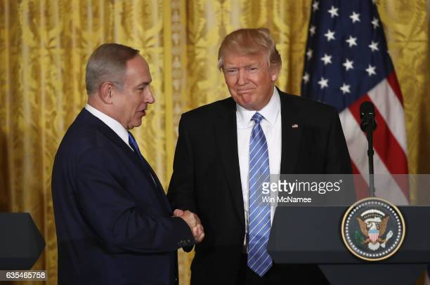 S President Donald Trump and Israel Prime Minister Benjamin Netanyahu shake hands during a joint news conference at the East Room of the White House...