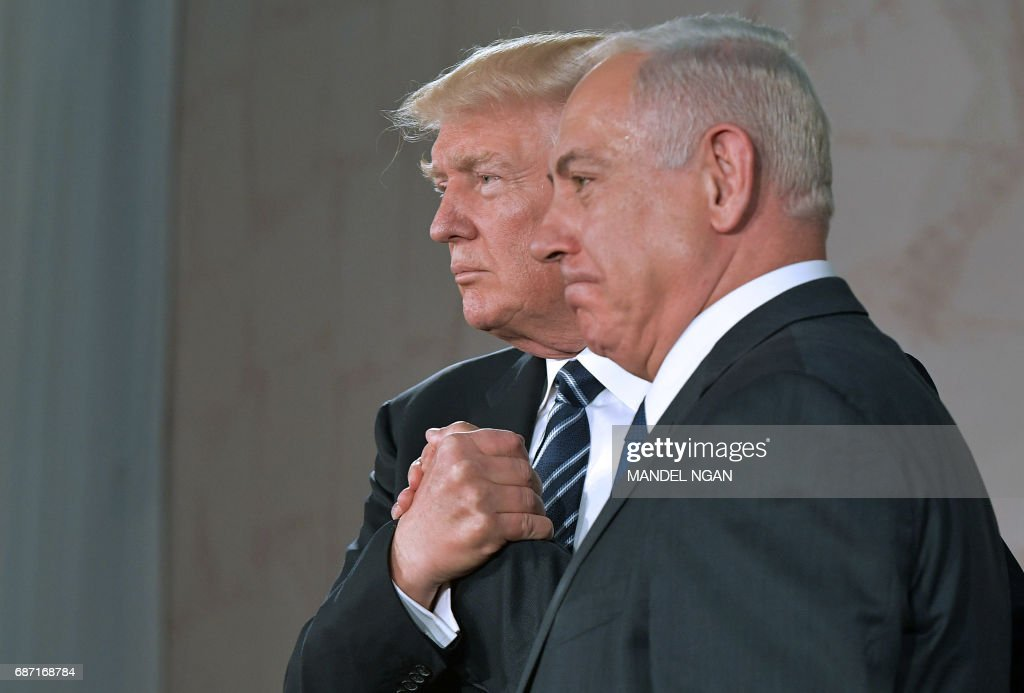President Donald Trump (L) and Israel's Prime Minister Benjamin Netanyahu shake hands after delivering a speech at the Israel Museum in Jerusalem on May 23, 2017. /