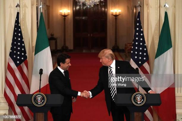 S President Donald Trump and Italian Prime Minister Giuseppe Conte shake hands during a joint news conference at the East Room of the White House...