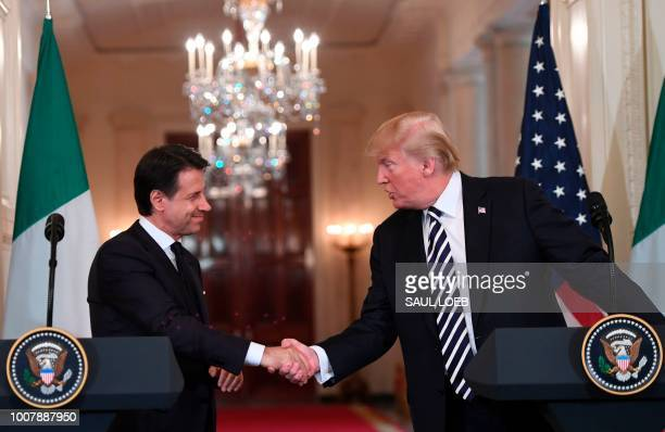 US President Donald Trump and Italian Prime Minister Giuseppe Conte shake hands as they hold a joint press conference in the East Room of the White...
