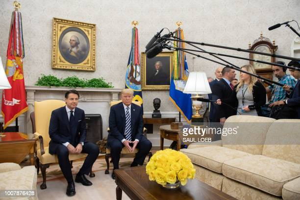 US President Donald Trump and Italian Prime Minister Giuseppe Conte hold a meeting in the Oval Office of the White House in Washington DC July 30 2018
