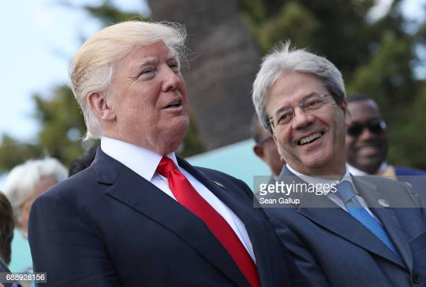 S President Donald Trump and Italian Prime Minister Paolo Gentiloni chat during the group photo for the G7 Outreach Program on the second and last...