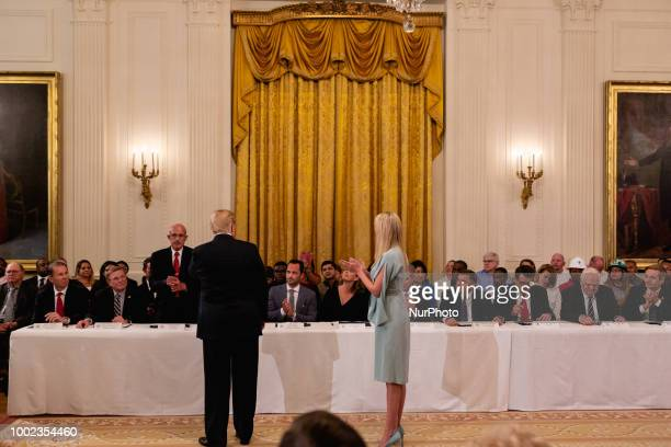 US President Donald Trump and Ivanka Trump welcome guests at an event where President Trump signed an executive order establishing a National Council...