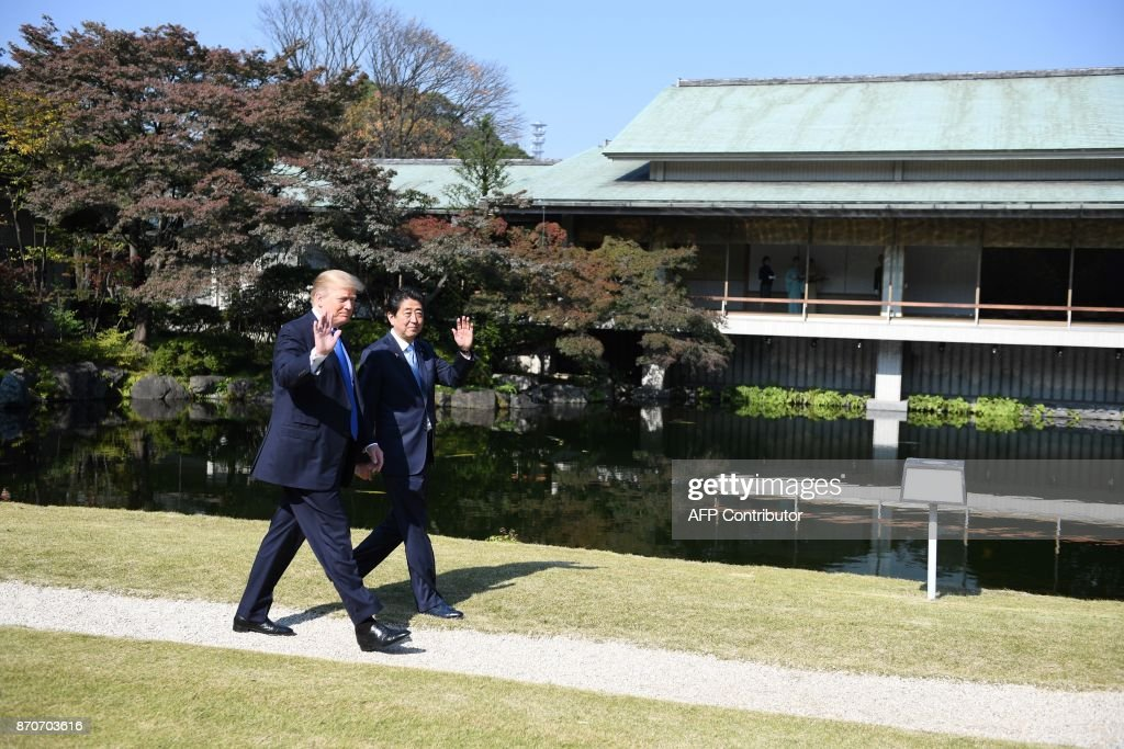 US President Donald Trump (L) and Japanese Prime Minister Shinzo Abe arrive at the Akasaka Palace in Tokyo on November 6, 2017. Trump lashed out at the US trade relationship with Japan, saying it was 'not fair and open', as he prepared for formal talks with his Japanese counterpart. /