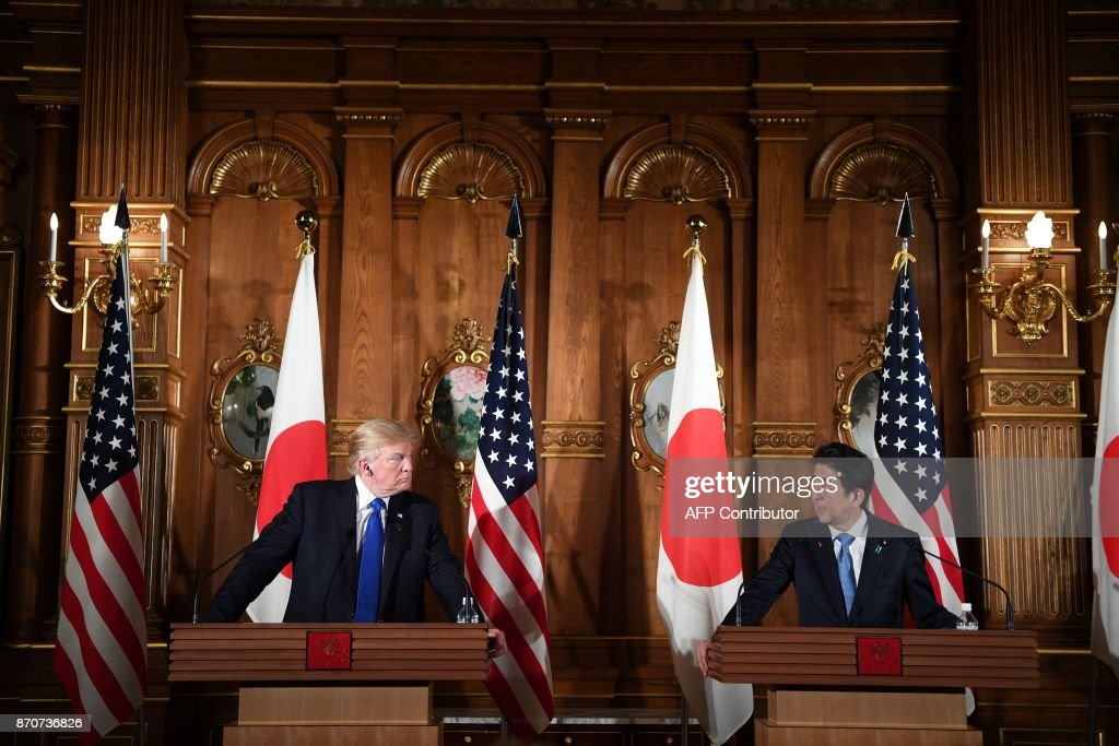 US President Donald Trump and Japanese Prime Minister Shinzo Abe (R) attend a joint press conference at Akasaka Palace in Tokyo on November 6, 2017. Donald Trump described North Korea's nuclear missile programme as a 'threat' to the world on a trip to Asia dominated by the crisis. /