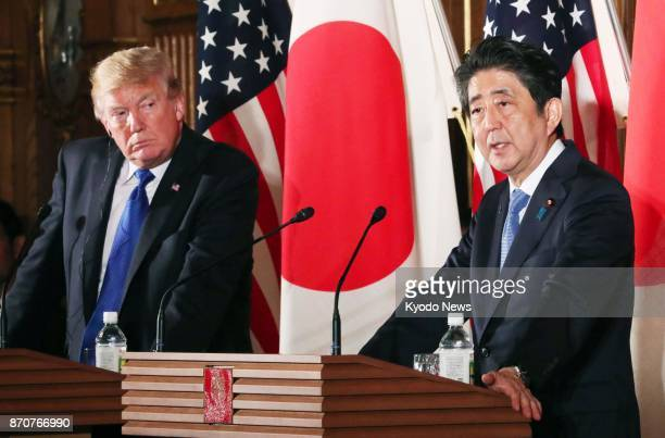 US President Donald Trump and Japanese Prime Minister Shinzo Abe hold a joint press conference at the State Guest House in Tokyo on Nov 6 2017 The...