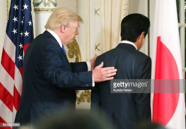 US President Donald Trump and Japanese Prime Minister Shinzo Abe leave a joint press conference in Palm Beach Florida on Feb 11 following the latest...