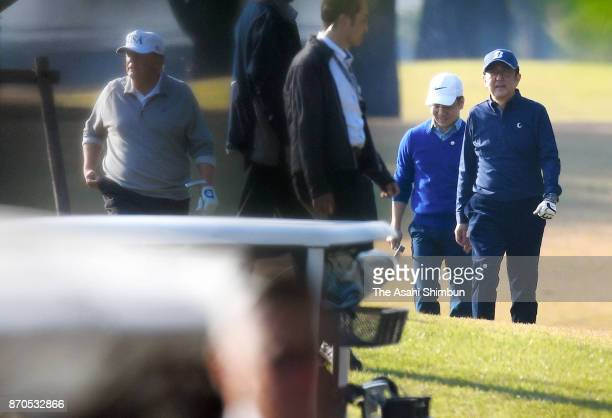 S President Donald Trump and Japanese Prime Minister Shinzo Abe play golf at Kasumigaseki Country Club on November 5 2017 in Kawagoe Saitama Japan...