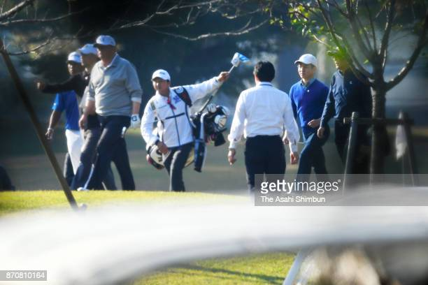 US President Donald Trump and Japanese Prime Minister Shinzo Abe play golf at Kasumigaseki Country Club on November 5 2017 in Kawagoe Saitama Japan...