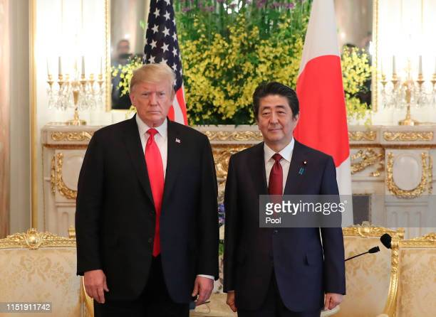 President Donald Trump and Japanese Prime Minister Shinzo Abe pose for a photo ahead of their meeting at Akasaka Palace, Japanese state guest house...