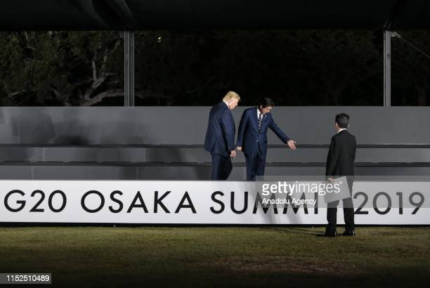 President Donald Trump and Japanese Prime Minister Shinzo Abe prepare to take part in family photo session on the first day of the G20 summit in...