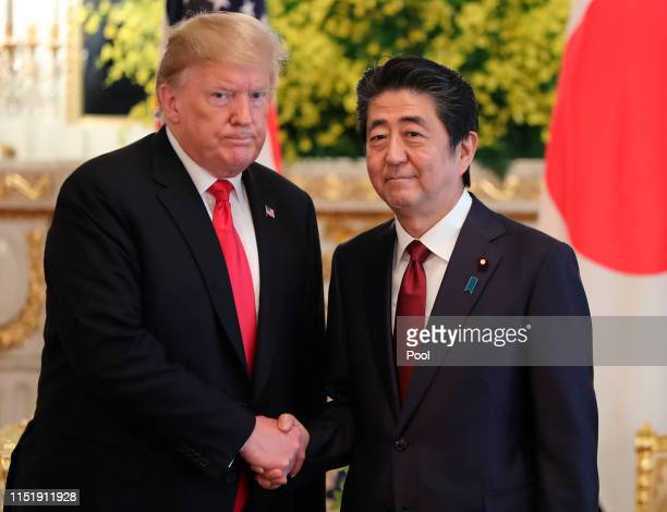 President Donald Trump and Japanese Prime Minister Shinzo Abe shake hands prior to their meeting at Akasaka Palace, Japanese state guest house on May...