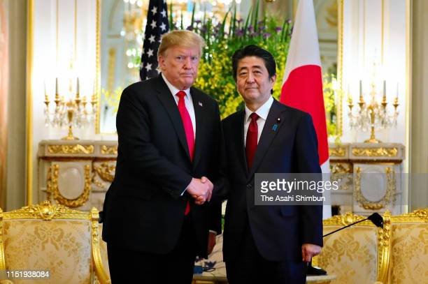 President Donald Trump and Japanese Prime Minister Shinzo Abe shake hands prior to their meeting at the Akasaka Palace, the State Guest House on May...