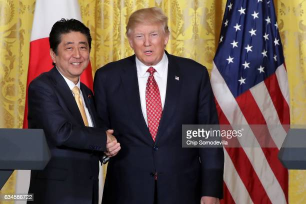 S President Donald Trump and Japanese Prime Minister Shinzo Abe shake hands at the conclusion of a joint news conference in the East Room at the...