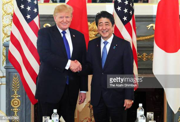 US President Donald Trump and Japanese Prime Minister Shinzo Abe shake hands prior to their meeting at the Akasaka State Guest House on November 6...