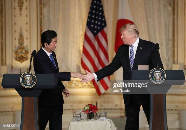 S President Donald Trump and Japanese Prime Minister Shinzo Abe shake hands at a news conference at MaraLago resort on April 18 2018 in West Palm...