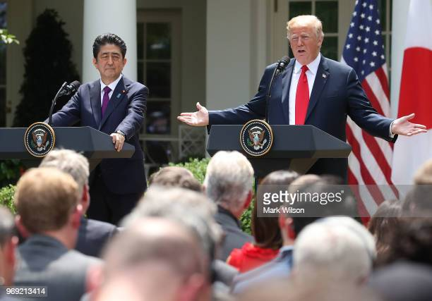 S President Donald Trump and Japanese Prime Minister Shinzo Abe speak to the media during a news conference in the Rose Garden at the White House on...