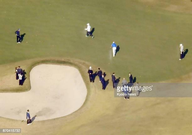 US President Donald Trump and Japanese Prime Minister Shinzo Abe watch professional golfer Hideki Matsuyama at Kasumigaseki Country Club in Kawagoe...