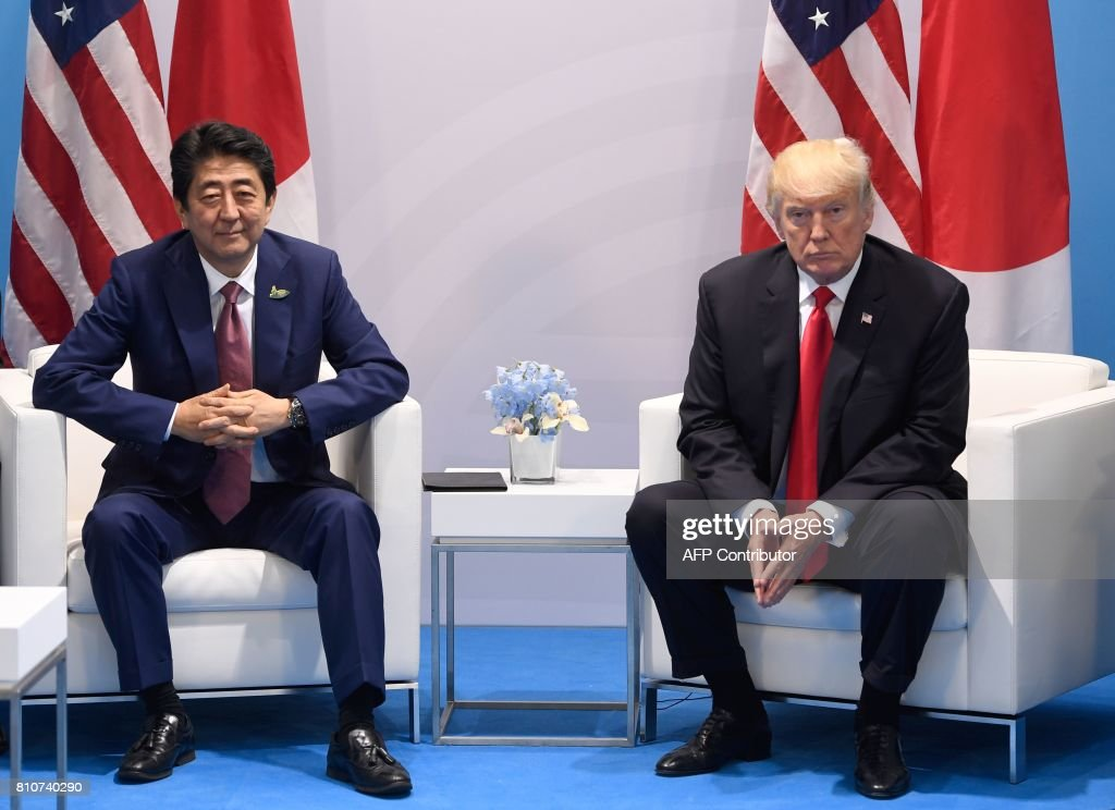 US President Donald Trump (R) and Japan's Prime Minister Shinzo Abe have taken seat for a bilateral meeting on the sidelines of the G20 Summit in Hamburg, northern Germany, July 8, 2017. Leaders of the world's top economies gather from July 7 to 8, 2017 in Germany for likely the stormiest G20 summit in years, with disagreements ranging from wars to climate change and global trade. /
