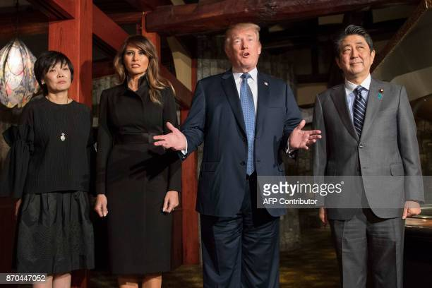 US President Donald Trump and Japan's Prime Minister Shinzo Abe meet with their wives Melania Trump and Akie Abe for a dinner at a restaurant in...