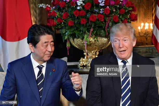 US President Donald Trump and Japan's Prime Minister Shinzo Abe share a laugh as they speak to media during a bilateral meeting at Trump's MaraLago...