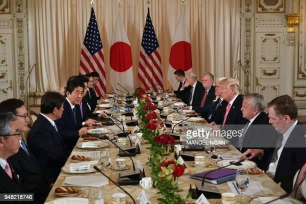 President Donald Trump and Japan's Prime Minister Shinzo Abe take part in a working lunch at Trump's Mar-a-Lago estate in Palm Beach, Florida on...
