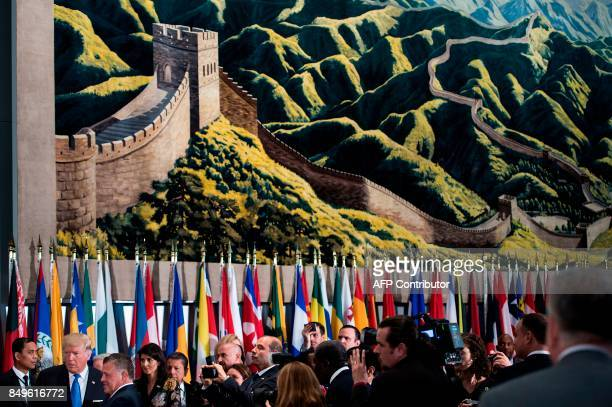 President Donald Trump and Jordan's King Abdullah II stand below a tapestry with the Great Wall of China before a luncheon at the United Nations...