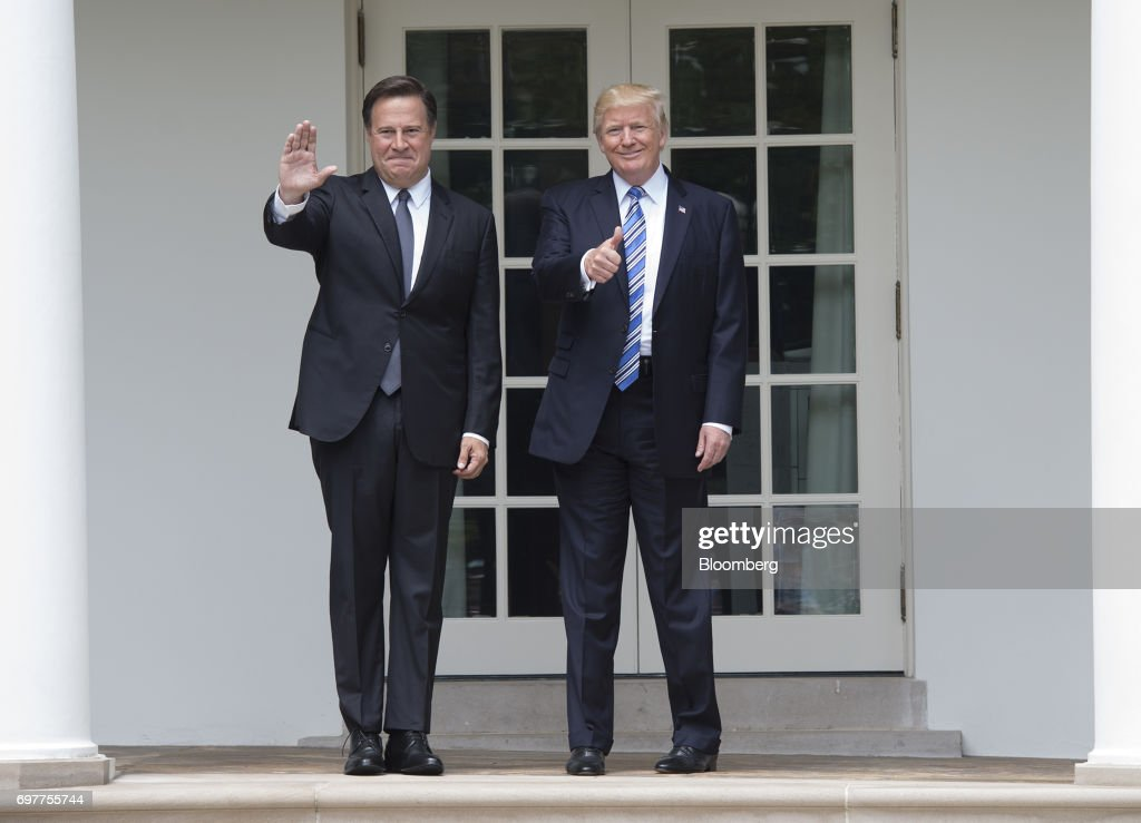 U.S. President Donald Trump, and Juan Carlos Varela, Panama's president, left, gesture to members of the media near the Oval Office at the White House in Washington, D.C., U.S., on Monday, June 19, 2017. The U.S. is Panama's number one source of imports, accounting for 17 percent or $4.68 billion of the country's total imports, according to Massachusetts Institute of Technology's Observatory of Economic Complexity. Photographer: Molly Riley/Pool via Bloomberg