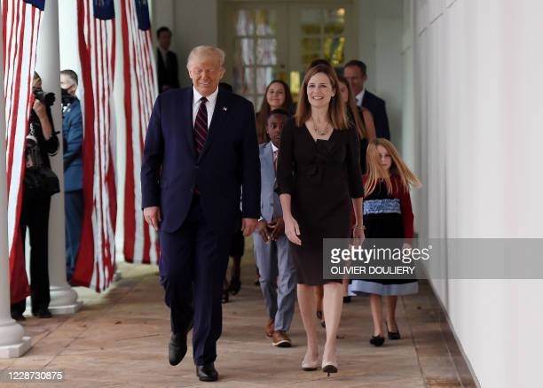 President Donald Trump and Judge Amy Coney Barrett walk to the Rose Garden of the White House in Washington, DC, on September 26, 2020. - Trump...