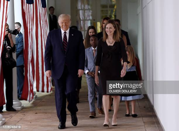 US President Donald Trump and Judge Amy Coney Barrett walk to the Rose Garden of the White House in Washington DC on September 26 2020 Trump...