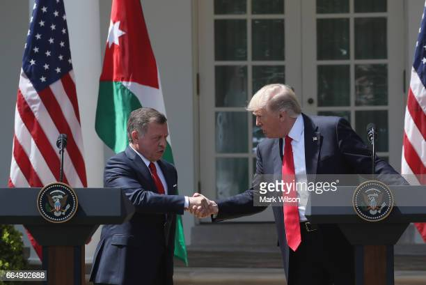 S President Donald Trump and King Abdullah II of Jordan shake hands before participating in a joint news conference at the Rose Garden of the White...