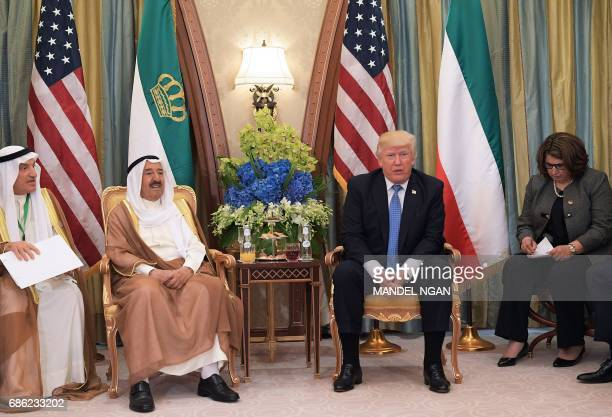 US President Donald Trump and Kuwait's Emir Sheikh Sabah alAhmad alJaber alSabah take part in a bilateral meeting at a hotel in Riyadh on May 21 2017...