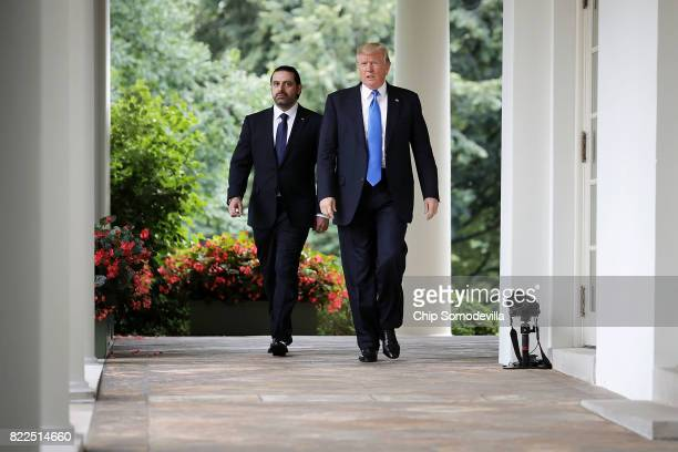 S President Donald Trump and Lebanese Prime Minister Saad Hariri walk into the Rose Garden for a joint news conference at the White House July 25...