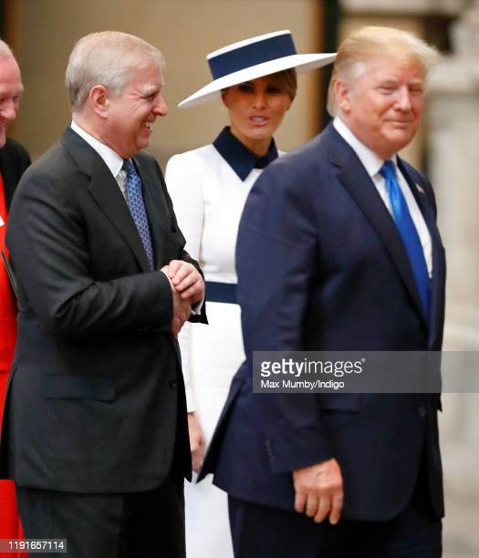 US President Donald Trump and Melania Trump accompanied by Prince Andrew Duke of York visit Westminster Abbey where he laid a wreath at the grave of...