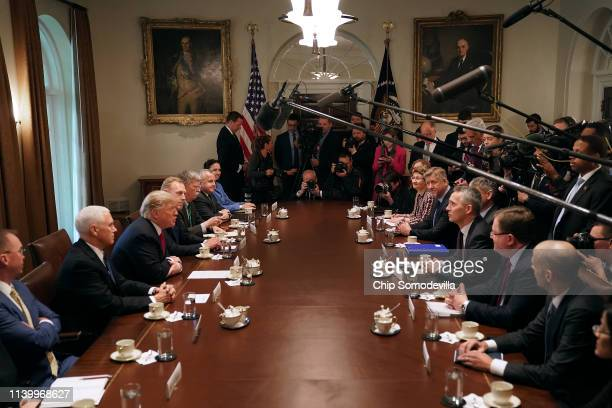 US President Donald Trump and members of his cabinet sit across from NATO Secretary General Jens Stoltenberg and his delegation during a bilateral...