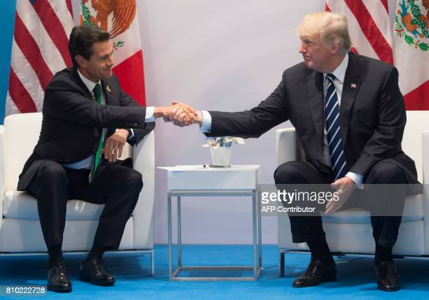 US President Donald Trump and Mexican President Enrique Pena Nieto shake hands during a meeting on the sidelines of the G20 Summit in Hamburg Germany...