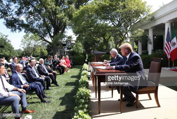 S President Donald Trump and Mexican President Andrés Manuel López Obrador sign a joint trade declaration in the Rose Garden at the White House July...