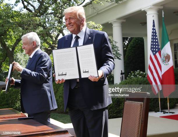 S President Donald Trump and Mexican PresidentAndrés Manuel López Obrador sign a joint trade declaration in the Rose Garden at the White House July...