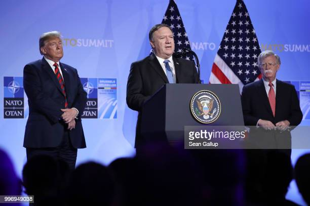 S President Donald Trump and National Security Advisor John Bolton look on as US Secretary of State Mike Pompeo speaks briefly to the media at a...