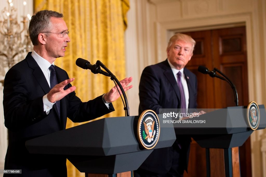 US President Donald Trump and NATO Secretary General Jens Stoltenberg (L) hold a joint press conference in the East Room at the White House in Washington, DC, on April 12, 2017. / AFP PHOTO / Brendan Smialowski