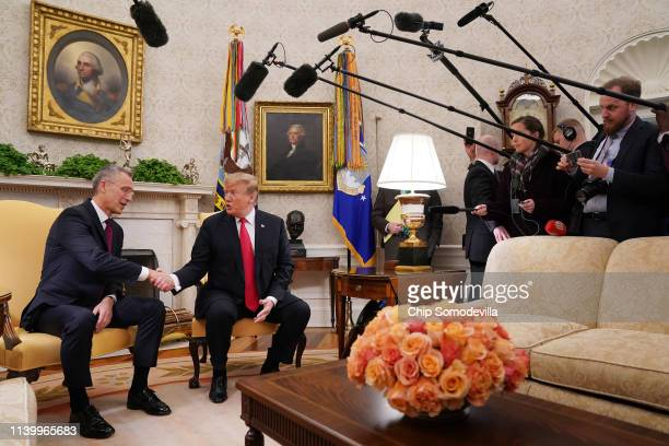 S President Donald Trump and NATO Secretary General Jens Stoltenberg talk to reporters in the Oval Office at the White House April 02 2019 in...