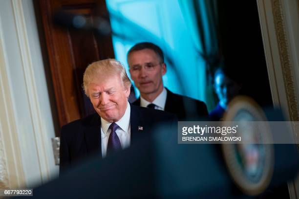 US President Donald Trump and NATO Secretary General Jens Stoltenberg arrive for a joint press conference in the East Room at the White House in...