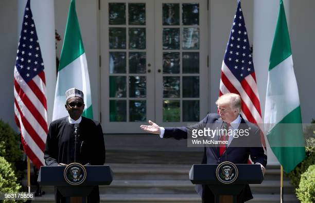 S President Donald Trump and Nigerian President Muhammadu Buhari answer questions during a joint press conference in the Rose Garden of the White...