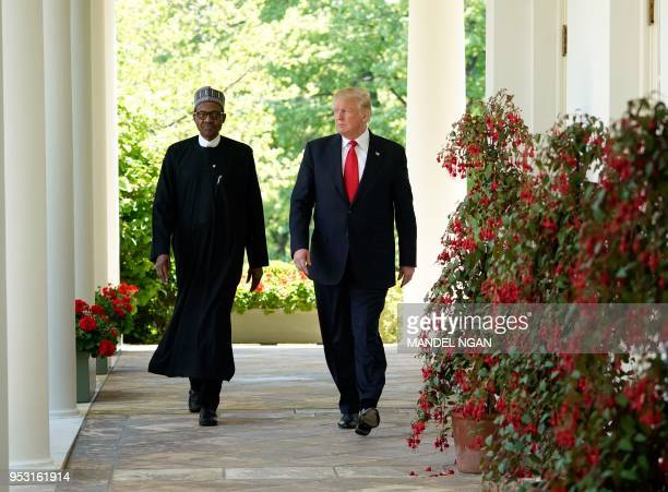 US President Donald Trump and Nigerian President Muhammadu Buhari arrive for a joint press conference in the Rose Garden of the White House on April...