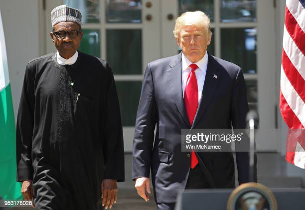 S President Donald Trump and Nigerian President Muhammadu Buhari arrive for a joint press conference in the Rose Garden of the White House April 30...